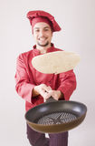 Chef with pan flips pancake Stock Images