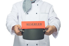 Chef with pan in hand Stock Image