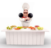 Chef with pan and lots of vegetable on the table Stock Image