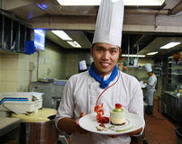Chef pastry. Smiling at work Royalty Free Stock Image