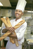 Chef pastry. At work holding french bread Royalty Free Stock Photo