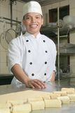 Chef at pastry. Smiling and happy Stock Image