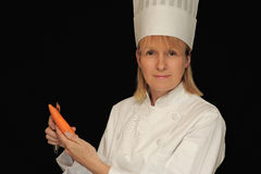 Chef peeling carrot Royalty Free Stock Photography