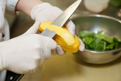 Chef is peeling mango Stock Images