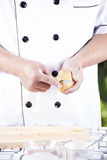 Chef peeling Potato with knife Royalty Free Stock Photos