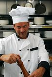 Chef with pepper grinder Royalty Free Stock Image
