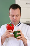 Chef and peppers Royalty Free Stock Images