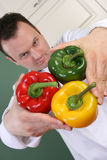 Chef and peppers Royalty Free Stock Photography