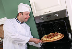 Chef and pizza Royalty Free Stock Photos