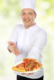 Chef with pizza Stock Photography