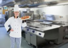 Chef with pizza in the restaurants kitchen Royalty Free Stock Photo