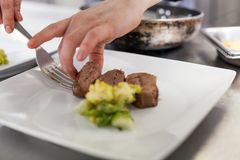 Chef plating up food in a restaurant royalty free stock photos