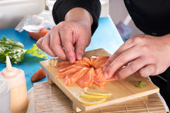 Chef plating up raw salmon for sashimi Royalty Free Stock Photo