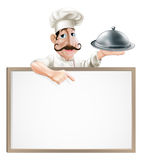 Chef with platter pointing at sign Royalty Free Stock Photo