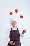 Chef play with food concept Royalty Free Stock Images