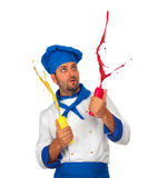 Chef plays with ketchup and mayonnaise Royalty Free Stock Images