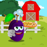 Chef plum with pizza pointing at viewer on a farm Royalty Free Stock Image