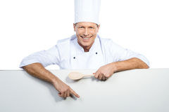 Chef pointing copy space. Stock Photography