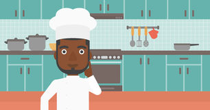 Chef pointing forefinger up. Stock Photos