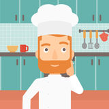 Chef pointing forefinger up. Stock Photography