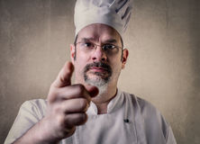 Chef pointing forward with his finger Royalty Free Stock Photos