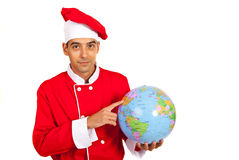 Chef pointing to world globe Stock Photography