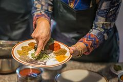 Chef points with finger to South Asian spices stock photo