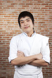 Chef portrait. Asian young chef crossing arms Royalty Free Stock Images