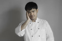Chef portrait, Asian young chef. Chef portrait, Asian young chef crossing arms Royalty Free Stock Images