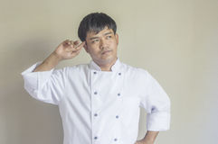 Chef portrait, Asian young chef. Chef portrait, Asian young chef crossing arms Royalty Free Stock Image