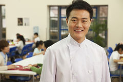 Chef portrait in school cafeteria Stock Images