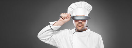 Chef  posing against gray background Royalty Free Stock Image