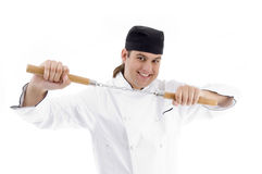 Chef posing holding nunchaku Royalty Free Stock Photos