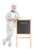 A chef posing near the board Royalty Free Stock Images