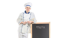 A chef posing near the board Royalty Free Stock Photography