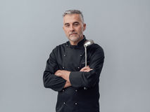 Chef posing with a spoon ladle royalty free stock photo