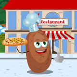 Chef potato with pizza showing thumb up in front of a restaurant Royalty Free Stock Photography