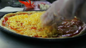 Chef pouring cheese on pizza blank stock video footage