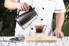 Chef pouring hot water to Fresh coffee Stock Image