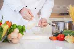 Chef Pouring Milk Into a Bowl Stock Image