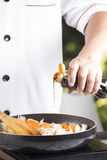 Chef pouring shoyu sauce to the pan for cooking Japanese pork cu Stock Photo