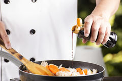 Chef pouring shoyu sauce to the pan for cooking Japanese pork cu Stock Image