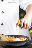 Chef pouring shoyu sauce to the pan for cooking Japanese pork cu Royalty Free Stock Images