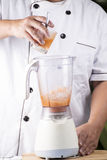 Chef pouring Thai Tea to Blender Royalty Free Stock Images