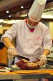Chef préparant le canard de Pékin chez Quan Ju De, Pékin Images stock