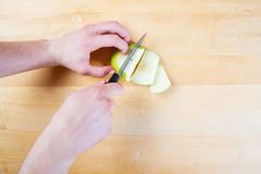 Chef prepare apple in the kitchen Royalty Free Stock Photo