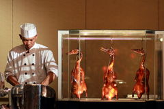 Chef prepare chinese duck. A chef prepare a menu of chinese peking roast duck Stock Photography