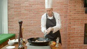 Chef prepare seafood mix for salad