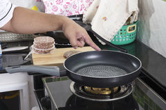 Chef prepared cooking Beef burger in the pan Royalty Free Stock Photo