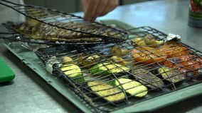 The chef prepared the fish and grilled vegetables. stock video